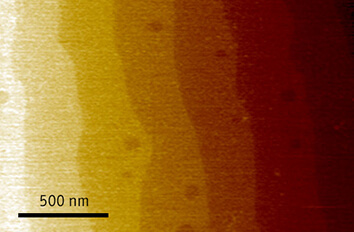 In situ AFM measurements of SrTiO3 and Co particles inside an electron microscope made with cryogenic scanning probe microscope attoAFM III